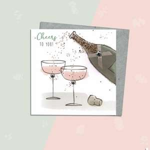 Sparkle Champagne Toast Female Birthday Card Alongside Its Silver Envelope