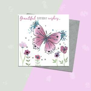 Glitzy Butterfly Female Birthday Card Alongside Its Silver Envelope