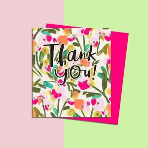 Thank You Card Alongside Its Neon Pink Envelope