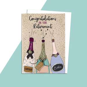 Retirement Card Featuring Champagne Bottles Alongside Its White Envelope