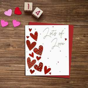 Lots Of Love Valentines Day Greeting Card Alongside Its Red Envelope