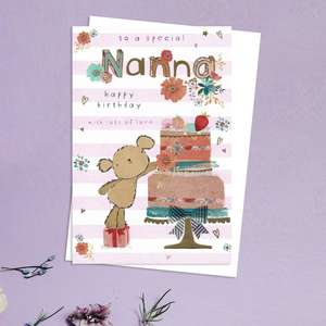 To A Special Nanna Happy Birthday Design Showing A Teddy Reaching Up To A Large Cake On A Stand. With Gold Foil Detail And White Envelope