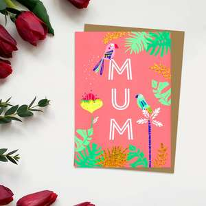 ' Mum' Mother's Day Card In Neon orange Showing A Parrot sitting On Top Of the Letters Of 'Mum'. With Added Gold Foil Detail And Brown Envelope