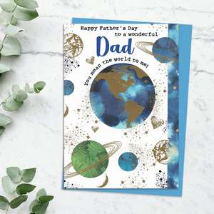 'Happy Father's Day To A Wonderful Dad You Mean The World To Me' Card Featuring The World And The Planets! With Stunning Gold Foil Detail And Blue Envelope