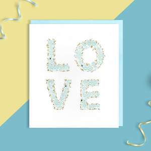 LOVE Wedding Card Displayed With Its Light Blue Envelope