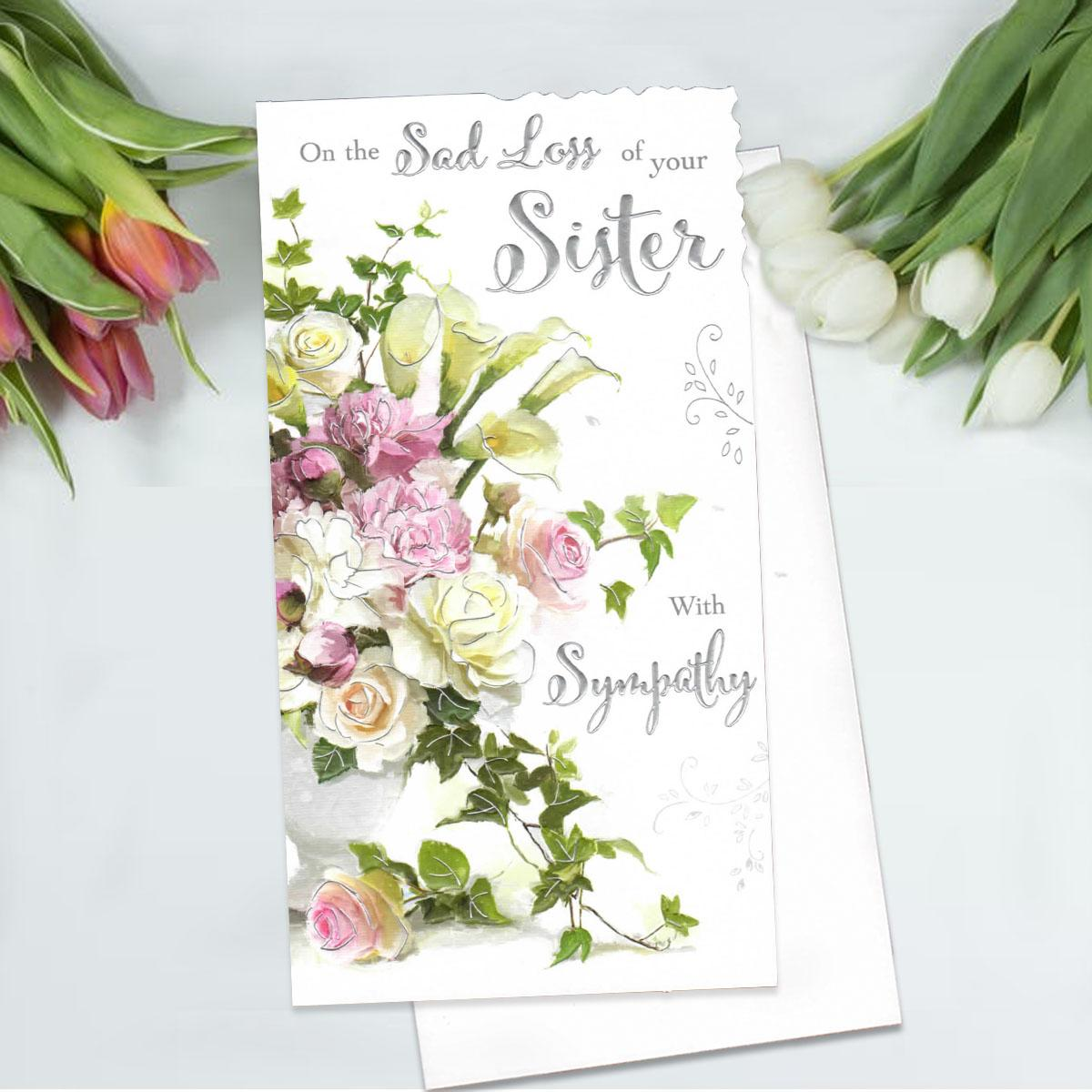 Floral Loss Of Sister Sympathy Card Alongside Its White Envelope