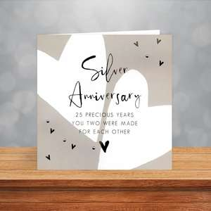 Silver Anniversary Card Sitting On A Wooden Display Shelf