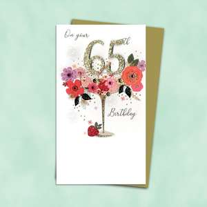 65th Cocktail Glass Themed Birthday Card Alongside Its Gold Envelope