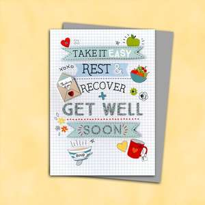 Get Well Soon Card Alongside Its Silver Envelope