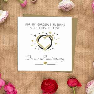 Husband Anniversary Card Alongside Its Kraft Envelope