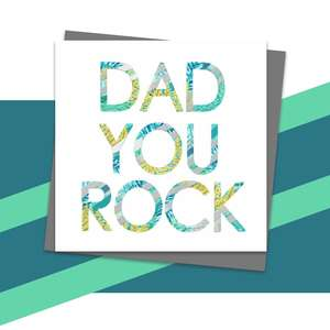 Dad You Rock Greeting Card Alongside Its Dark Grey Envelope