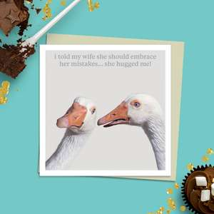Beautiful Photographic Funny Card showing Two White Swans. Caption: 'I Told My Wife She Should Embrace Her Mistakes...She Hugged Me!' Blank Inside For Own Message. Complete With Stone Coloured Envelope
