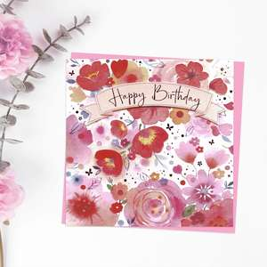 Happy Birthday Inside A Banner Surrounded By Flowers For This Design By Noel Tatt. With Added Pink Foil Detail And Pink Envelope