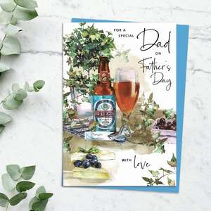 'For A Special Dad on Father's Day With Love' Card Featuring A Glass And Bottle Of Beer With Cheese And Grapes. With Discreet Sparkle And Blue Envelope