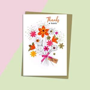 Thank You Floral Greeting Card Alongside Its Gold Envelope