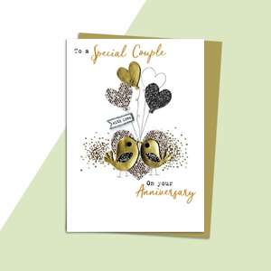 Love Birds Anniversary Card Alongside Its Gold Envelope