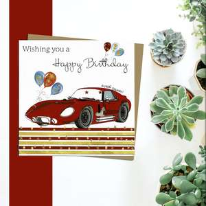 Red Sports Car Themed Birthday Card Alongside Its Silver Envelope