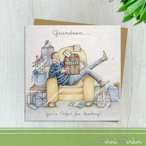 Showing A Young Man On The Armchair Surrounded By Gifts. Caption: Grandson...You're Perfect For Spoiling! Blank Inside For Own Message. Complete With Brown Kraft Envelope