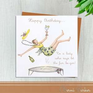 Happy Birthday To A Lady Who Says Let The Fun Be-Gin! Shows Lady On A Trampoline With Glass Of Gin In hand. Blank Inside For Own Message. Bronze Coloured Envelope