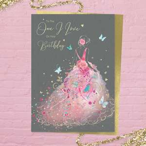 'To The One I Love On Your Birthday' card from the 'Grace' range. Featuring a beautiful lady In a pink frothy, flowing dress. Added sparkle and gold foil detail. Printed insert with colour image and heartfelt verse. Complete with gold colour envelope