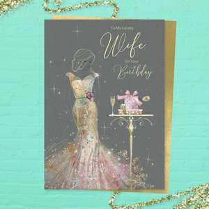 'To My Lovely Wife On Your Birthday' card featuring a beautiful lady in a long gold dress with champagne and gifts. With added sparkle and gold foil detail. Colour image inside with heartfelt verse. Complete with gold colour envelope