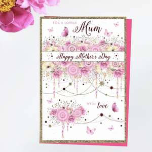 ' For A Lovely Mum Happy Mother's Day With Love' Featuring Garlands, Flowers And Butterflies In Pink. With Added Gold Foil Detail And Bright Pink Envelope