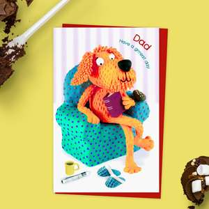 ' Dad Have A Grrreat Day' birthday card showing a shaggy dog sat in an armchair with slippers and book! Complete with red envelope