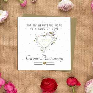 Wife Anniversary Card Alongside Its Kraft Envelope