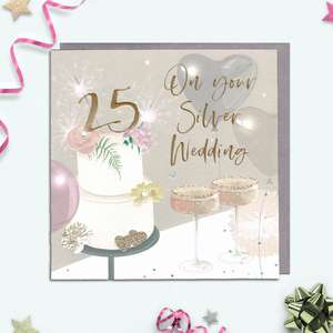 This Stunning Contemporary Silver Wedding Anniversary Card  Features Muted Pastels Greys And Pinks. It shows A Wedding Cake And Champagne Glasses. Finished In Gold Foiling And Completed With A Co-Ordinating Grey Envelope. Blank Inside For Your Own personal Message