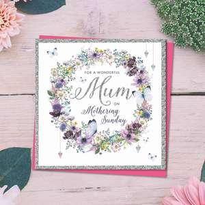 ' For A wonderful Mum On Mothering Sunday' Featuring A Garland Of Purple Flowers. With Silver Foil Border And Detail. Complete With bright Pink Envelope