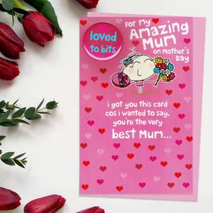 'For My Amazing Mum On Mother's Day' Card Featuring A Cartoon Girl With Chocolates And Flowers. With 'Loved To Bits' Badge Attached. Complete With Pink Envelope