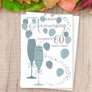 'On Your Diamond Anniversary Celebrate 60 Happy Years' Card Featuring Two Flutes With Balloons. With Beautiful Silver Foil Detail And White Envelope