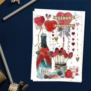 ' Husband Happy Anniversary' Card Featuring Balloons, Champagne, Dipped Strawberries And Gifts! Enhanced With Gold Foil Detail And Complete With White Envelope
