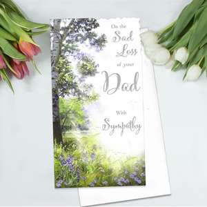 Loss Of Day Sympathy Card Alongside Its White Envelope