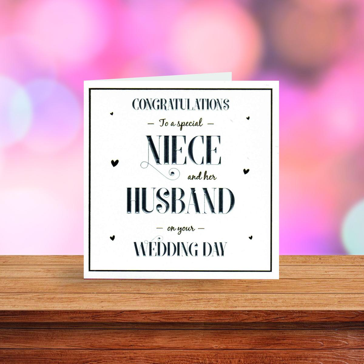 Niece And Husband Wedding Card Displayed On A Wooden Shelf