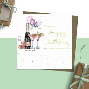 ' Wishing You A Happy Birthday Chin Chin On Your Special Day' Featuring A Bottle Of Fizz, Balloons And Macarons. Added Sparkle And Embellishment. Blank Inside For Own Message. Complete With Brown Kraft Envelope