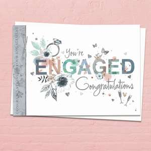 'You're Engaged Congratulations' Card. This 'Landscape' Card Features A Diamond Ring with Beautiful Floral Adorned Letters Of 'Engagement' . With Beautiful Silver Foil Detail And White Envelope
