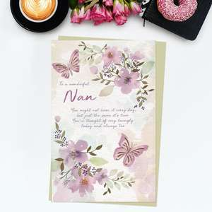 ' To A Wonderful Nan' Birthday Card Featuring Beautiful Pastel Pink and Lilac Flowers And Butterflies. With Gold Foil Detail And Taupe Envelope