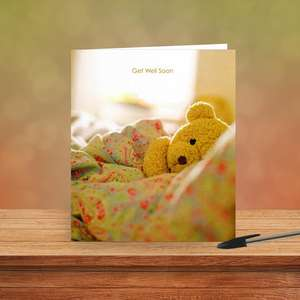 Get Well Soon Teddy Bear Card Sitting On A Display Shelf