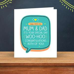 Mum And Dad Anniversary Card Sitting On A Wooden Display Shelf