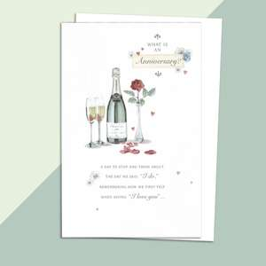 Sentimental Anniversary Card Alongside Its White Envelope