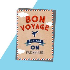 Bon Voyage Card Alongside Its Silver Envelope