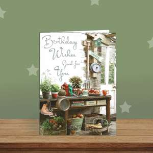 Gardening Themed Birthday Card Alongside Its White Envelope