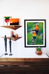 Parrots wall art print in a black frame