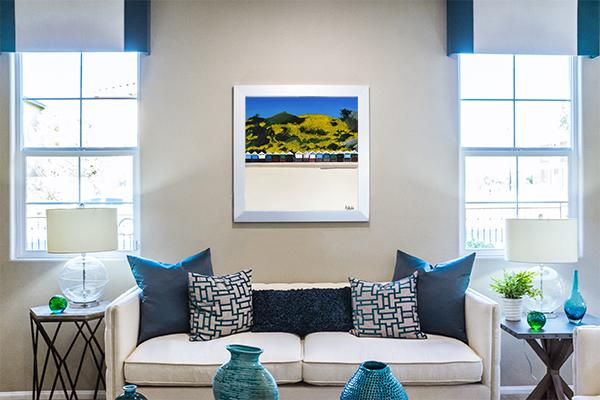Stylish living room with a colourful painting of the beach huts in Bournemouth England