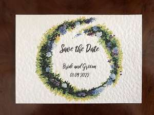 Save the date with painted flowers and modern typography