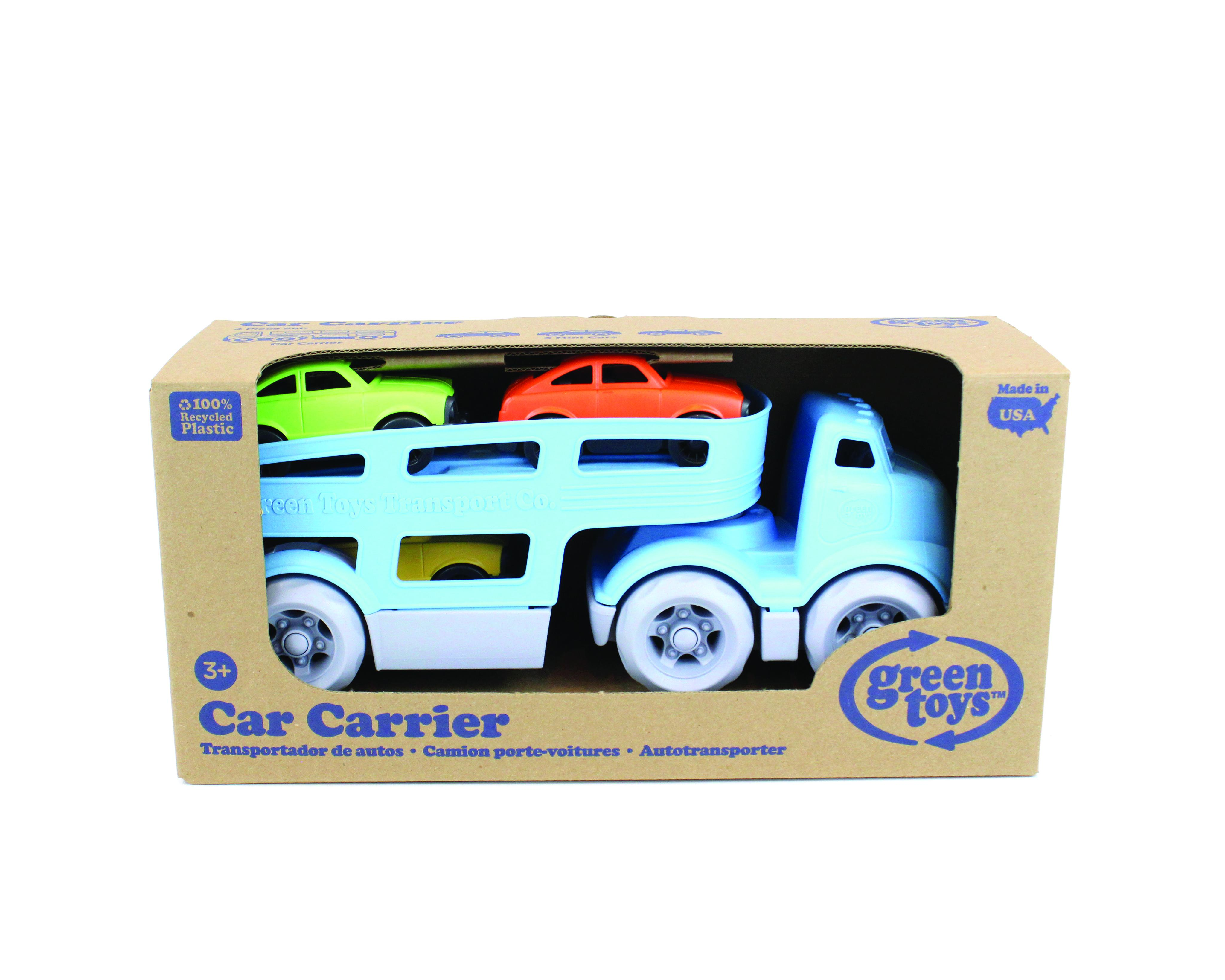 Cardboard packaging holding car transporter toy.