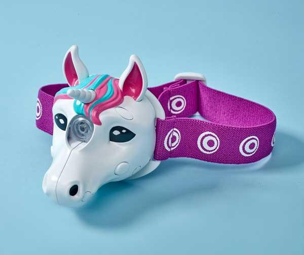 Unicorn head torch with purplish head-band on a blue background.
