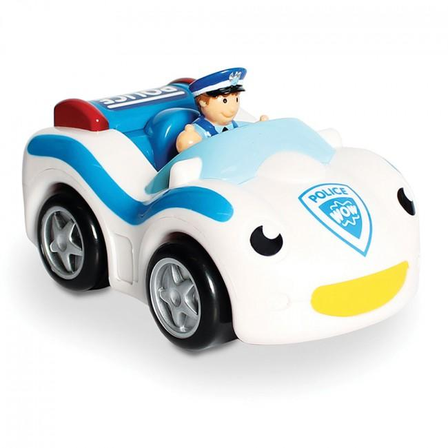 Toy police car with toy policeman.