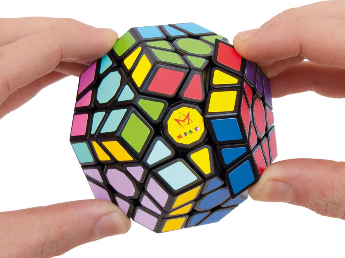 Hands moving the parts of the Megaminx puzzle.